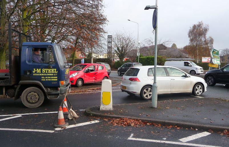 Pensioner's crash brings County Road to a halt