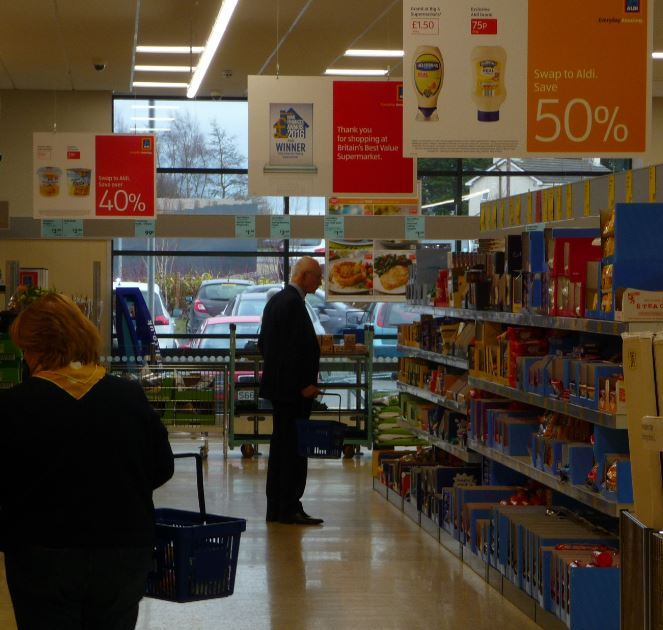 Aldi staff in the new Burscough superstore got more than they bargained for on Friday afternoon when a surprise shopper called in.    Edwin J Booth, chairman of upmarket grocers Booths, spent ten minutes looking round the newcomer to the Ringtail Retail Park – and do some discount shopping.  ...
