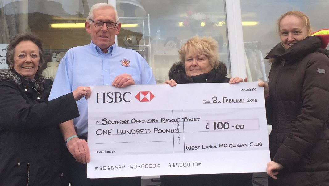 Pictured outside the Southport lifeboat charity shop are Nigel Malyan (chairman of West Lancs MG Owners Club) presenting a cheque to the charity.    With him, left to right, are Sharon Anson, Cath Wilson (founder member) and Michelle Wilson.     This is the second of the club's charity cheques of...