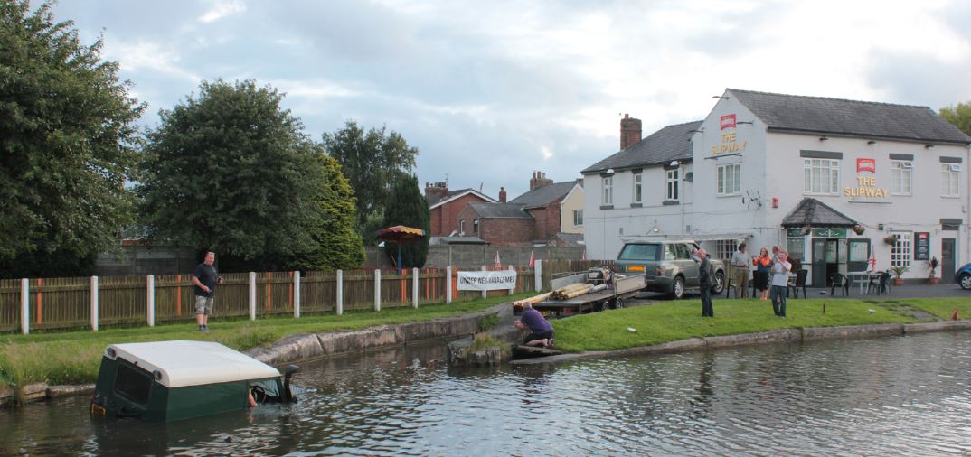 On Saturday evening, a hapless Land Rover driver decided to try some high jinks fun at the Slipway pub near Burscough by driving the vehicle down the concrete slipway into the Leeds and Liverpool canal.    Unfortunately the driver didn�t realise that the concrete slipway ended not far below water...