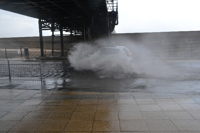Torrential rain has caused flooding under Southport Pier. Many motorists simply turned around and chose a different route while other took the risk of a flooded engine.        Flooding under.  the pier