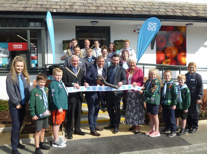 Aughton was in a very co-operative mood on Thursday - and no wonder!    The transformed Cockbeck is its latest community store with a small knot of customers ready and waiting for the official opening by Liverpool soccer legend Alan Kennedy, deputy mayor Noel Delaney and deputy mayoress Ann...