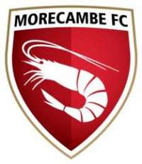 Morecambe  looked set to celebrate their 50th league game at the Globe with   victory when they were 2-0 up with 20 minutes to go but it all went  wrong as they shipped three late goals to sink to a third successive  home defeat.      Morecambe  had the best possible start when they went a goal up...